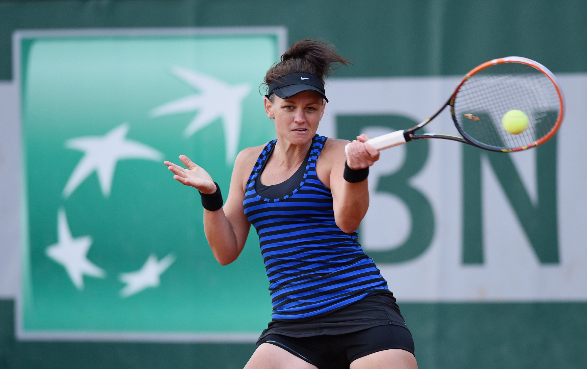Casey Dellacqua plays a forehand during her French Open win on Tuesday. Picture: Getty Images.
