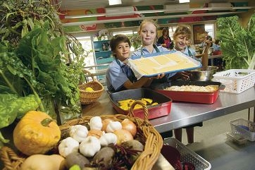 Year 3 students Jonathon Roberts, Breanna Johnstone and Ghenwa Dannaoui have been using produce from the school garden in the kitchen to make food. Picture: Emma Reeves d420209