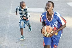 Chudier Lap plays basketball with his brother D.J. (5).