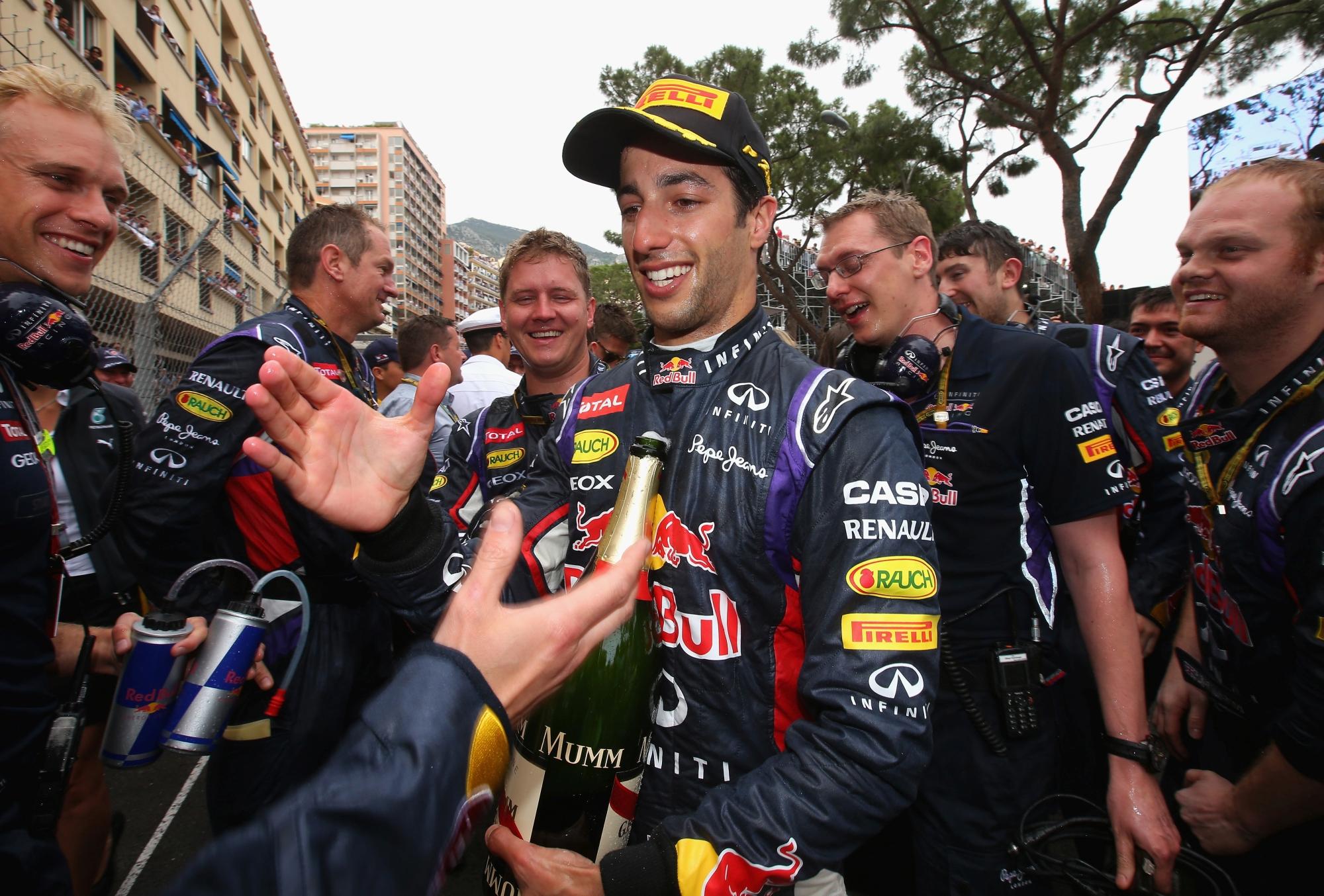 Duncraig's Daniel Ricciardo celebrates his podium finish with team mates. Picture: Getty Images.