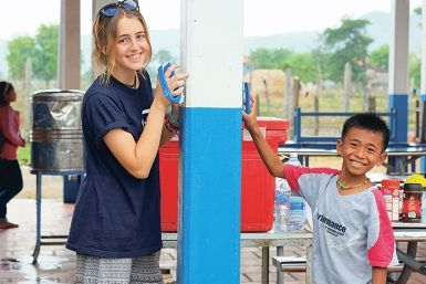 Perth College Year 10 student Hannah Brown, of Inglewood, with a student at Sunshine House in Cambodia where she volunteered earlier this year.