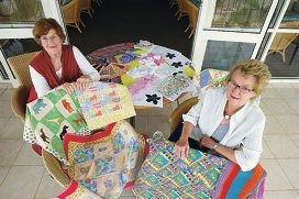 Coralie Clarke and Ann Jenkins of Harbourside Quilters with a selection of the group's work. Picture: Emma Reeves d420376
