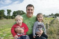 Matt Harris with his children, Logan (18 months) and Grayerson (3), who are likely to be among the first students of the new primary school in East Landsdale.