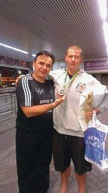 Head coach Adrian Tesanovic with wrestling champ Troy Humberston.