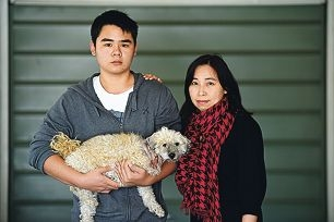 Cora Lam with her son Kenneth and their injured pet Jordie.