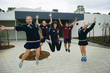 Year 6 students Mickayla Dal Pozzo, Chad MacPherson, Naomi Plewright, Kevin Dang and Allie Archel celebrate the opening of the new Year 7 buildings at their college.