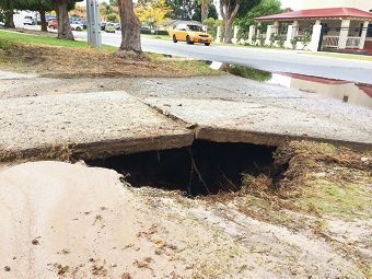A burst water pipe severely damaged Sarah Carville's driveway in Pitt Street last week, leaving her without a water supply for about seven hours.