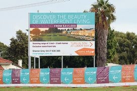 An advertisement along Great Eastern Highway in South Guildford regarding the sale of land lots.
