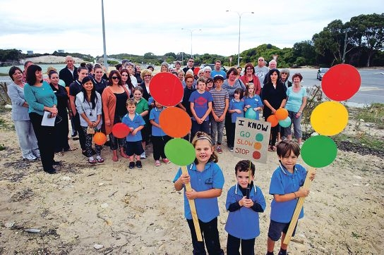 Youngsters Myah Jacob, Bowen Gawthorne and Ted Tudor join local residents to call for traffic signals at the intersection of Marmion Avenue in Yanchep. Picture: Emma Reeves www.communitypix.com.au d419477