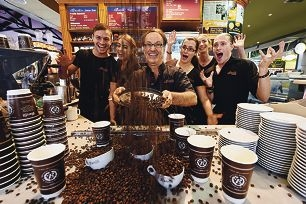 Bocelli's Espresso owner Leone Agnello and loyal staff celebrate their win. Picture: Marcus Whisson www.communitypix.com.au d419508