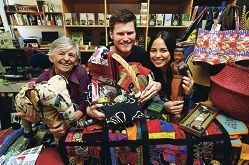 Oxfam volunteers, from left, Anne Batt, Luke Walsh and Brenda Castaneda with a selection of fair trade products [NAMES OK]