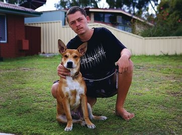 Zac Skelton with Boof, the only one of the three dogs that wasn't hurt. Boof has become untrusting and aggressive since the attack.