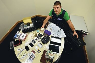 Bayswater Police Station's Constable Scott Starkie with stolen goods and mail .