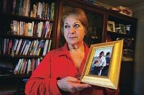 Ramzi of Willetton (Surname with-held).  Seen here with a picture of her late husband wearing the stolen watch.  Ramzi's husband died a year ago. Her house was robbed this week and they stole her husbands watch, which had been in the family for years.
