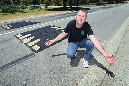 Craig Van Der Laan at the speed bumps last year, which have now had bollards installed next to them. |Picture: Bruce Hunt www.communitypix.com.au d412043