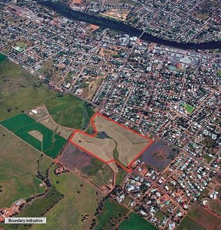 An aerial shot of the land for sale.