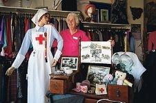 Red Cross Scarborough staff member Rae Matheson with wartime memorabilia inside the shop.www.communitypix.com.au d418825