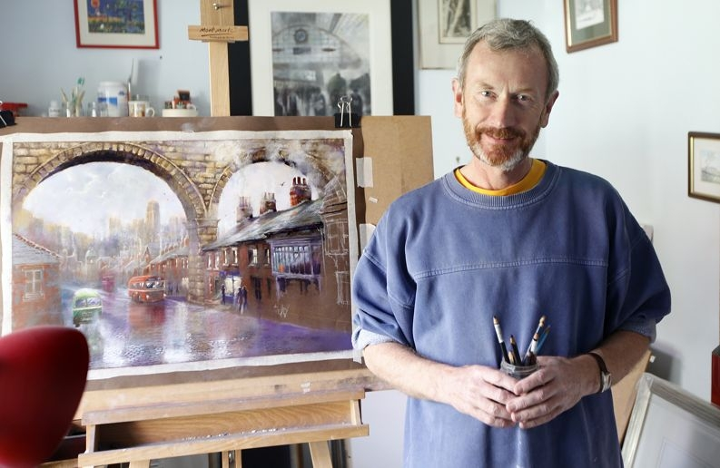 Artist Anthony Turner with one of his English paintings.