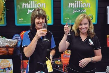 Store assistant Shirley Seddon and NewsXpress Meve manager Pat Shepley celebrate the newsagency's big Oz Lotto win.