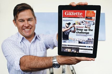 Mayor of Fremantle Brad Pettitt checks out the latest local news on his iPad.