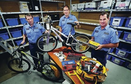 Sgt Roy George, Acting Snr Sgt Gavin Kerber and Acting Inspector Ash Goy with stolen items waiting to be claimed.