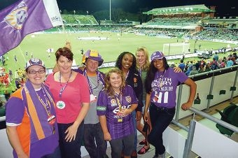 Members and coaching staff of Rockingham City Senior Women's division five team at a Perth Glory game.