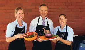 Community Services Minister Tony Simpson with Foodbank's Stephanie Godrich and Leisha Aberle.