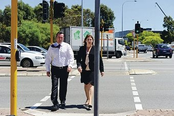 Opposition Leader Mark McGowan with West Swan MLA Rita Saffioti crossing Reid Highway on Malaga Drive.d412397