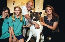 Students Alyssa Whalan and Ruby Malcolm with akita Thor and his owner Charlie Baughen and puppeteer Jessica |Harlond-Kenny. Picture: Elle Borgwardd418179