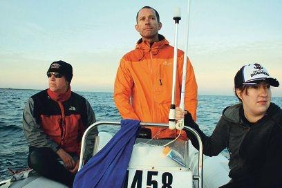 Observers Neil Henderson, Sian Coggin and Andrew Corbe off the coast near Fremantle.