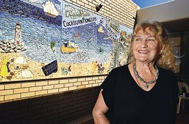 Artist Sarah Francis with the community mural.