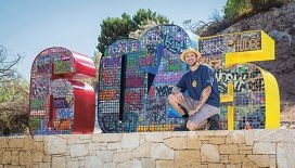 Trevor Bly with his artwork created in memory of Craigie SHS.