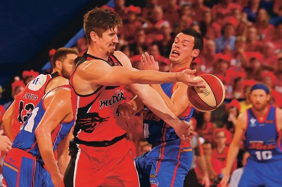 Greg Hire under pressure in game one against Adelaide.