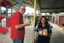 Bunnings' Peter Kingwell with Principal Sue Waterhouse and Bunnings' Julie Otremba. Picture: Emma Reeves d418172