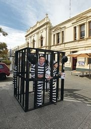 Willagee MLA Peter Tinley and Fremantle MLA Simone McGurk thank visitor Lynne New for contributing to their bail money.