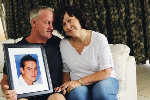 Peter and Anita Miller with a photo of their son Rhys Connor.