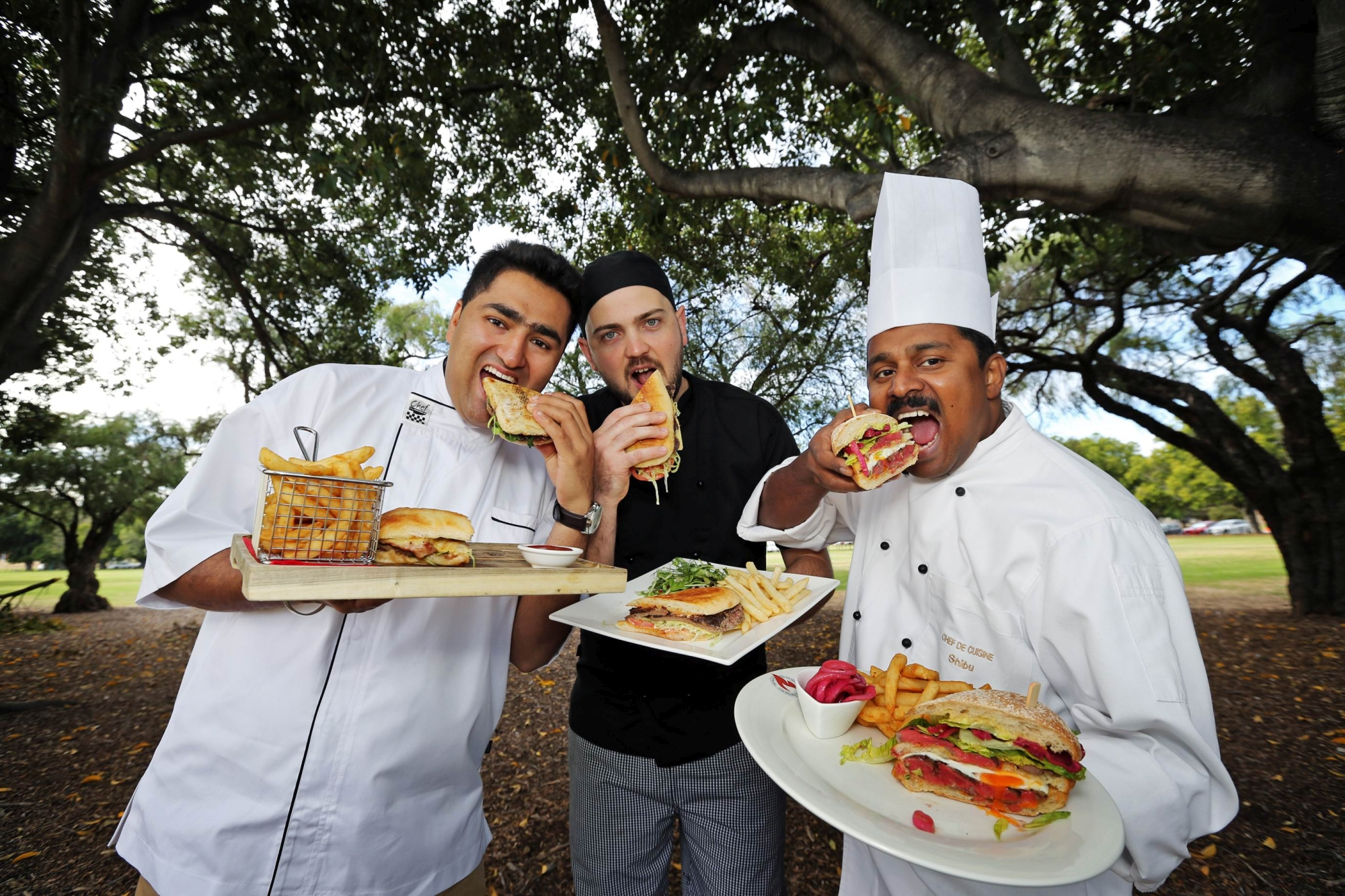 Mickey Phull, from The Karalee on Preston, Adam Knox, from The Belmont, and Shibu Aravindakshan, from Junction Grill Crown Perth, prepare for WA's Best Steak Sandwich event. Picture: David Baylis www.communitypix.com.au d417817