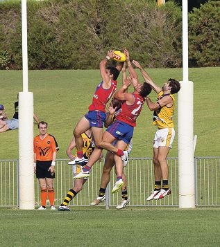 Anthony Tsalikis takes a strong mark for West Perth. Picture: Dan White.