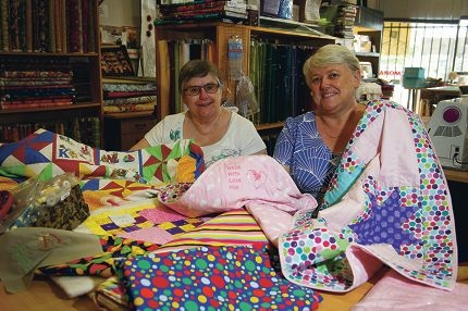 Quilter Helen Robartson with Ocean Keys Sewing Centre owner Faye Peskett. Picture: Emma Reeves d417365