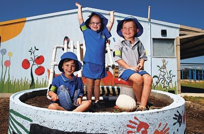 Indya Webb, Tiarna-Anne Howes and Xavier Allen at play in an area of Bertram Primary School's sensory garden. Picture: Elle Borgward www.communitypix.com.au d416623