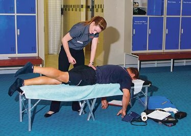 Chiropractic student Emma Cohn treating a client.