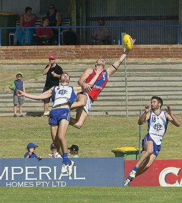 West Perth's Jordan Jones at full stretch in the clash against East Fremantle.