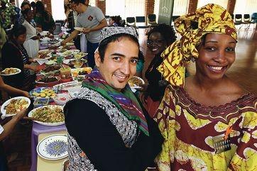 Bashir Ahmadyar with Godelive Lukunga celebrate Harmony Day.