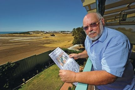 Glenn Winchester is upset at plans for a retaining wall and fence next to his property. Picture: Jon Hewson d416718