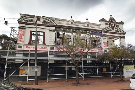 The restoration of the Guildford Hotel, which has fallen into unsightly disrepair, remains stuck in red tape. d410751