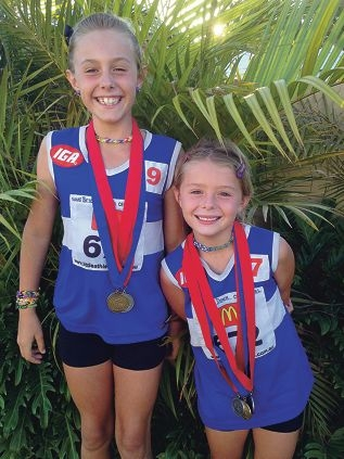Little Athletics stars Brianna and Holly Dutch, who won medals in the state championships recently.