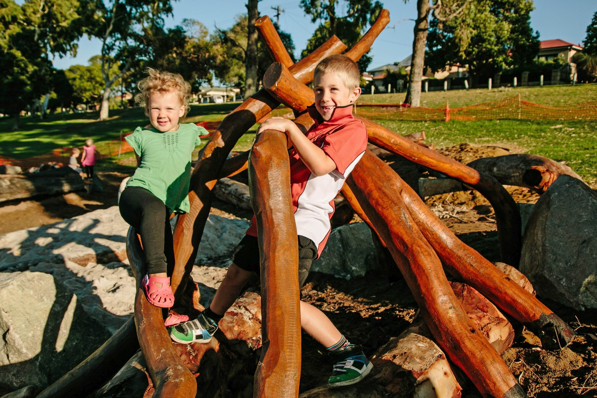 Willagee children Nate Shawscott (7) and his sister Taya (2) play in a newly constructed cubby at Webber Reserve's naturebased play area. Picture: Astrid Volzke
