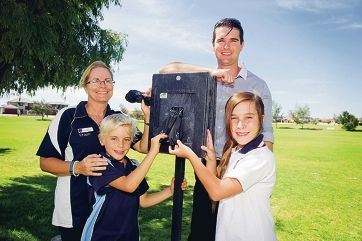 Quinns Beach PS teacher Kim Hughes, Connor Hughes (Year 4), associate principal Ben Sweet and Tiana Auty (Year 7) with the new poo bag dispenser. Picture: Emma Reevesd416628