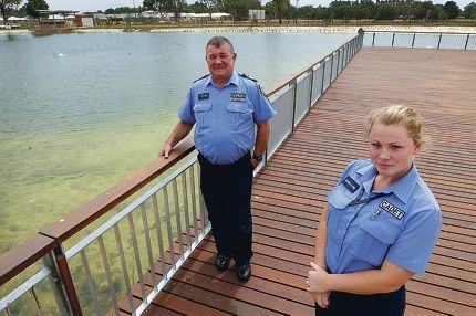 Senior Sergeant Mike Newman and Cadet Kayleigh Fletcher at the lake. Picture: Marcelo Palacios d416861