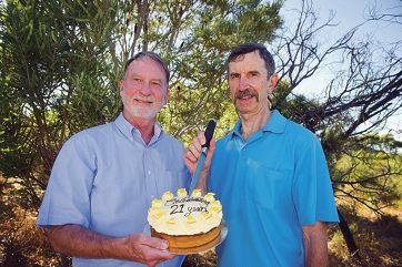 John Hudson and Ralph Henderson with a cake to mark the milestone. Pictures: Emma Reeves d416415
